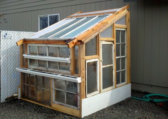Greenhouse For Less Than $100?!? - Fabulessly Frugal on building a greenhouse with old windows, greenhouse from recycled materials, greenhouse from pallets, greenhouse from pvc pipe, greenhouse from shed, greenhouse windows for the home, building a greenhouse with storm windows, greenhouse windows for kitchen, greenhouse made out of windows,